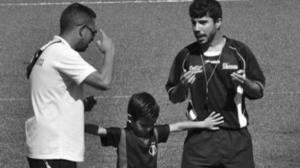 niño y entrenador